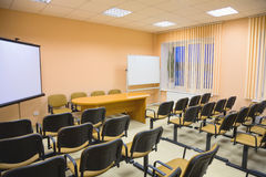 Modern interior of a conference hall in pink tones Stock Photography