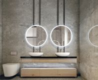 Modern interior design of bathroom vanity, all walls made of stone slabs with circle mirrors, minimalistic and clean concept stock photo