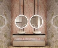 Modern interior design of bathroom vanity, all walls made of stone slabs with circle mirrors royalty free stock image