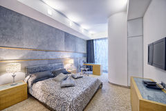 Modern interior design bedroom town real estate. Russia, Moscow - modern designer renovation in a luxury building. Stylish bedroom interior with double bed Royalty Free Stock Images