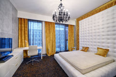 Modern interior design bedroom town real estate. Russia, Moscow - modern designer renovation in a luxury building. Stylish bedroom interior with double bed Royalty Free Stock Photography