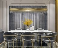 Modern interior design of grey gold dining room with side console and wooden slabs wall, dark and moody night scene stock image