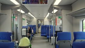 Modern interior of the high-speed train swallow with passengers on seats. Moscow, Russian Federation – July 15, 2017: modern interior of the high-speed train stock video