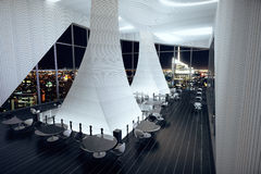 Modern interior of a large restaurant with black floors and lar Stock Images
