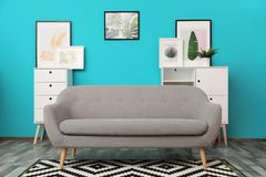Modern interior of living room with comfortable gray sofa. Near color wall royalty free stock images