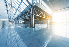Modern interior. Lobby and corridors of modern office building or airport, glass walls and reflective floor, natural light and flare Stock Photography