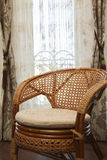 Modern interior with nice furniture inside. Wicker chair in the Royalty Free Stock Image