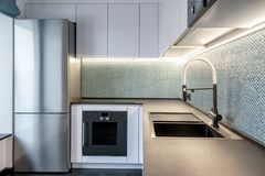 Modern Interior Of Kitchen With Lighting Royalty Free Stock Photos