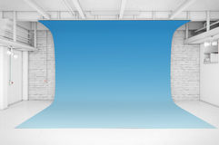 Modern Interior of Photo Studio with blue background Stock Image