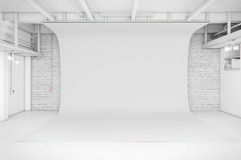 Modern Interior of Photo Studio with white background Royalty Free Stock Image