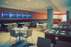Interior of restaurant. Modern interior of restaurant with tv wall Royalty Free Stock Image
