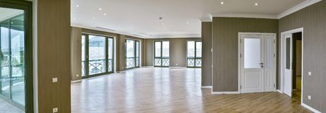 Modern interior, wide empty apartment with windows royalty free stock images