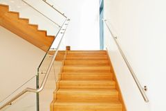 Modern interior with wooden stairs Stock Photography