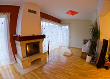 Modern Interiors. A fisheye view of modern interiors with a fireplace Stock Photos