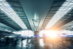 Modern international airport terminal lit by sun light Stock Photo