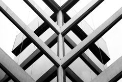 Modern intersections. Reflections of a building upon itself on the reflective sruface of the window panels Royalty Free Stock Photography