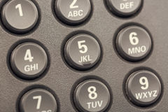 Modern IP digital phone buttons with numbers close up with selective focus. Toned.  Stock Photography