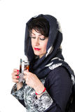 Modern iranian woman with a cup of tea. Picture of a modern iranian woman with a cup of tea Royalty Free Stock Photo
