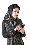 Modern iranian woman with smart phone. Picture of a iranian woman with smart phone Stock Images