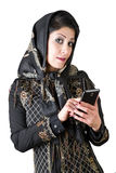 Modern iranian woman with smart phone. Picture of a iranian woman with smart phone Stock Image