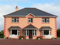 Modern Irish house. Painted in the traditional way Stock Photos