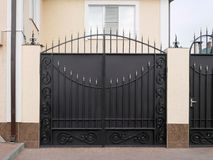 Modern iron gate with wrought-iron decor in the old style stock photos
