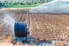 Modern irrigators on a contryside field.  Stock Images