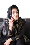Modern islamic woman with smart phone Royalty Free Stock Images