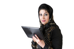 Modern islamic woman with tablet pc. Picture of a modern islamic woman with tablet pc Royalty Free Stock Photography