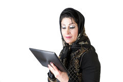 Modern islamic woman with tablet pc. Picture of a modern islamic woman with tablet pc Royalty Free Stock Photos