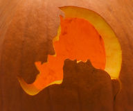 Modern jack-o'-lantern. Jack-o'-lantern carved with image of vampire about to bite woman's neck Stock Photo