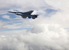 Modern Jet Plane Flying Above the Clouds Royalty Free Stock Photos