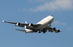 Modern jetliner landing Stock Photo