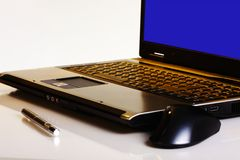 Modern job. Close-up of a lap top with mouse and pen royalty free stock images