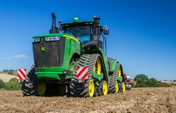 Modern john deere caterpilla tractor cultivating English crop field Stock Photo