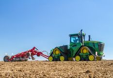 Modern john deere caterpilla tractor cultivating English crop field Royalty Free Stock Photography