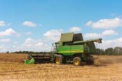 Modern john Deere combine at harvest time Royalty Free Stock Photo