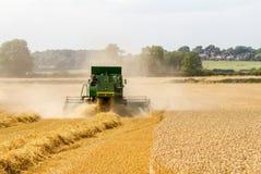 Modern John Deere combine harvester cutting crops Stock Image