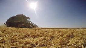 Modern John Deere combine harvesting grain in the field stock footage