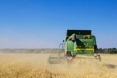 Modern John Deere combine harvesting grain in the field Stock Photo