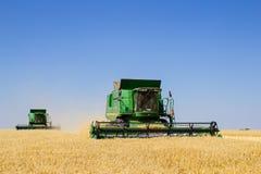 Modern John Deere combine harvesting grain in the field Royalty Free Stock Photos