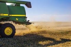 Modern John Deere combine harvesting grain in the field Royalty Free Stock Images