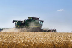 Modern John Deere combine harvesting grain in the field Royalty Free Stock Image