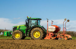 Modern John Deere tractor drilling seed in field Stock Photography
