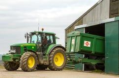 Modern John Deere tractor parking green trailer Royalty Free Stock Photos