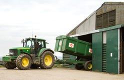 Modern John Deere tractor parking green trailer Stock Image