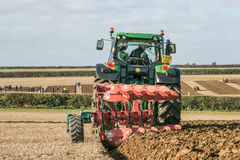 Modern John Deere tractor pulling a plough Royalty Free Stock Photo