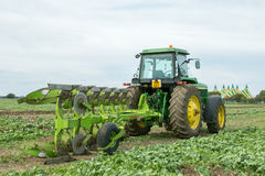 Modern John Deere tractor pulling a plough Royalty Free Stock Photography