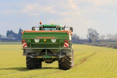Tractor and fertilizer spreader in field Royalty Free Stock Photo