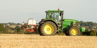 Modern john deere tractor Tractor spraying field stubble crops Stock Photography
